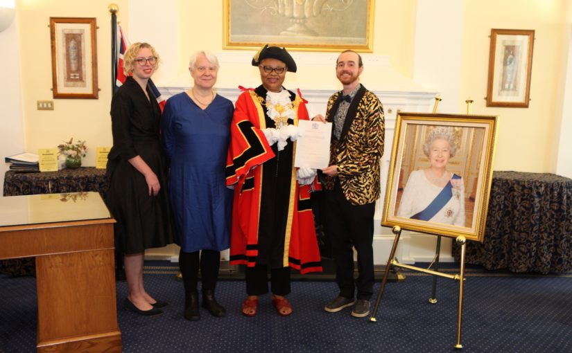 Sonia, Paula, the speake of Tower Hamlets council and me with a photo of the queen